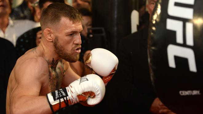 Conor McGregor hits an uppercut bag during a media workout in preparation for his fight against Floyd Mayweather, Jr. at UFC Performance Institute.
