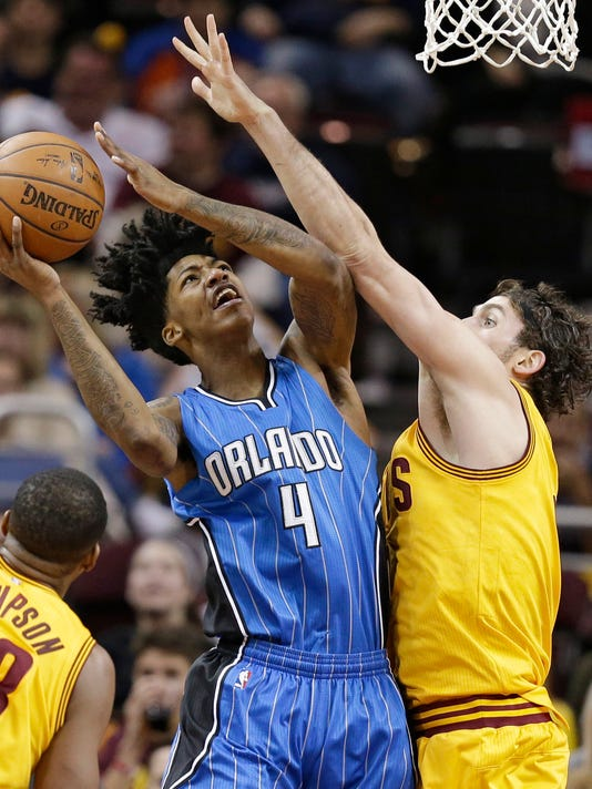 Orlando Magic's Elfrid Payton (4) shoots over Cleveland Cavaliers' Kevin Love, right, in the first half of an NBA basketball game Saturday, Jan. 2, 2016, in Cleveland. (AP Photo/Tony Dejak)