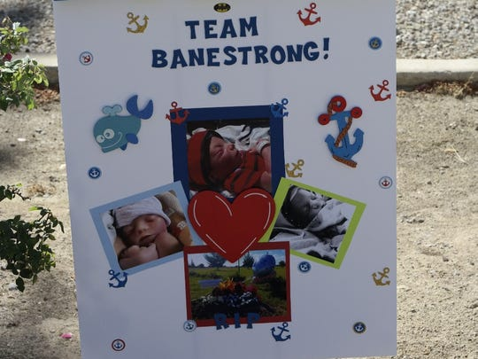 A poster expresses support for Team BaneStrong at the 2015 March of Dimes annual March for Babies. A Las Cruces family lost their son Bane at birth.