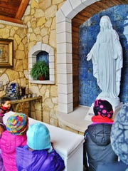 Students visit the Mary Mother of God grotto at Durward's Glen near Baraboo.