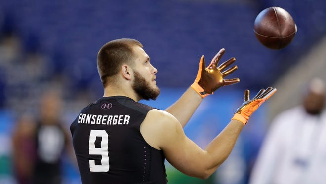 Western Michigan running back Donnie Ernsberger runs a drill during the NFL football scouting combine, Friday, March 2, 2018, in Indianapolis.