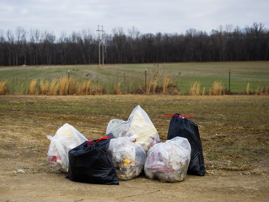 Bags of collected garbage sit near the street during the Henderson Trash Talk Pick-Up, along Wolf Hills Road in Henderson, Saturday, Jan. 28, 2017.