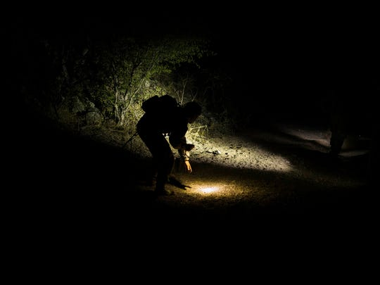 Arizona Border Recon volunteers carry flashlights,