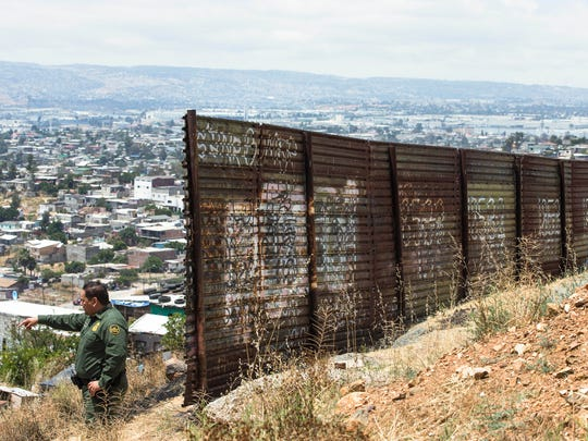 U.S. Customs and Border Protection Agent Joe Hernandez, at the U.S.-Mexico border fence in San Diego, says a border wall would be beneficial.