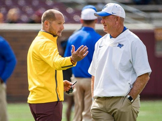 Minnesota coach P.J. Fleck and MTSU coach Rick Stockstill talk during pregame warmups Sept. 16, 2017, at TCF Bank Stadium.
