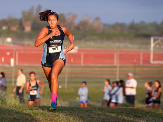 Carroll High School varsity girl Jolea Cortez leads the pack in the District 30-5A cross country meet at Dugan Track Stadium on Friday, October 13, 2017.  She placed first overall with a time of 20:26.61.