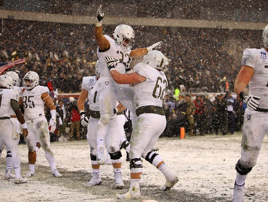 Army running back Darnell Woolfolk (33) celebrates