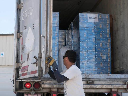 Jorge Lopez, a trucker from Transportes Oa, unloads
