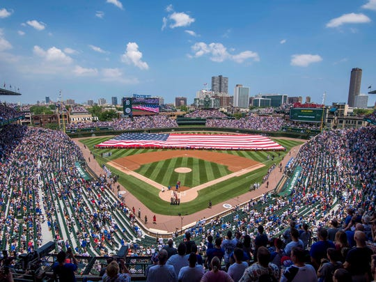 The American flag is seen stretched out during the national anthem prior to a game between the Chicago Cubs and the Detroit Tigers at Wrigley Field. The Cubs won the game, 5-2.