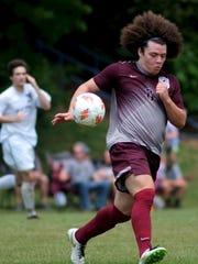 Bearden's Caleb Wilkins (6) runs down the ball during