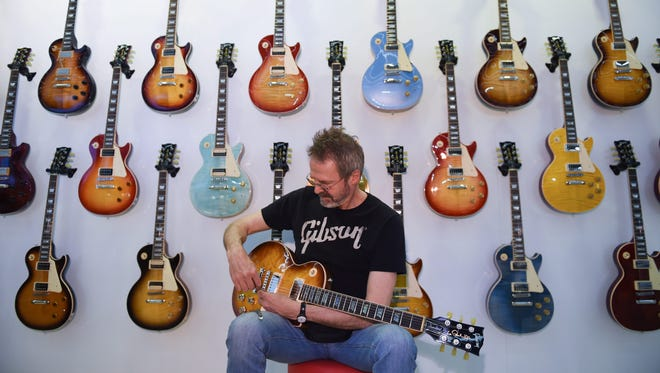Andy Knapp prepares guitars for the presentation at the stand of guitar manufacturer Gibson at the international music fair 'musikmesse' in Frankfurt am Main, Germany, 14 April 14, 2015.