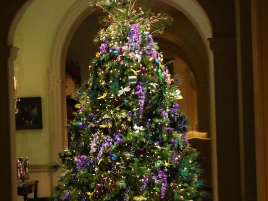 Yuletide includes a tree decorated in the colors and groupings common in Louis Comfort Tiffany's glass designs, to honor the exhibition now on display.