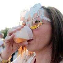 "Pam Deshotel takes a sip of one of her beer samples while sporting a pair of ""beer goggles"" during Gulf Brew, a beer-tasting event benefiting the Acadiana Center for the Arts, Saturday, October 18, 2014, at Parc International in downtown Lafayette."