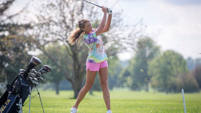 Delta's Ashlie Powell practices with her team Monday afternoon at Lakeview Golf Course in Eaton. Powell finished in third place during the Central sectional last season.
