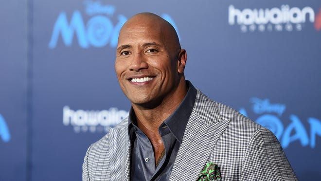 "Actor Dwayne Johnson arrives at the premiere of Disney's ""Moana"" at the El Capitan Theatre on Nov. 14, 2016 in Hollywood, California."