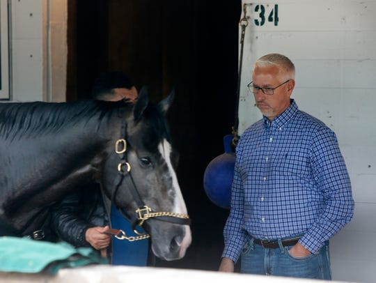 Trainer Todd Pletcher watched one of his horses walking