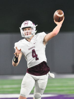Brownwood quarterback Tommy Bowden throws a pass during the Lions' 44-34 loss to Wichita Falls Hirschi in last year's Region I-4A bi-district playoff at Abilene Christian University's Wildcat Stadium.