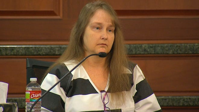 Kim Williams testified during the punishment phase of her husband's murder trial on December 16, 2014.