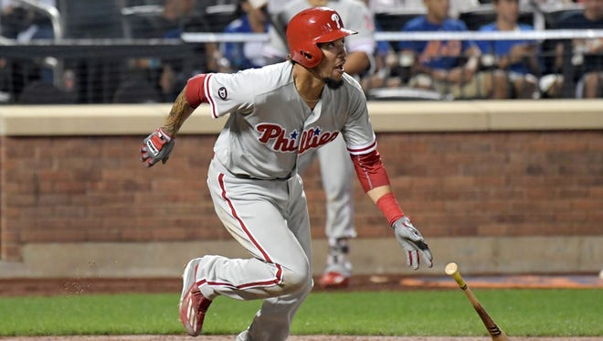 Philadelphia Phillies' J.P. Crawford hits a bloop single during the fifth inning Tuesday against the New York Mets at Citi Field. It was Crawford's first hit of his career, coming in his Major League debut.