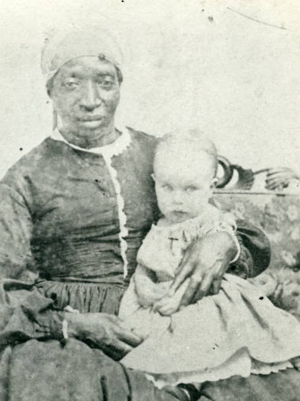 Jints, a slave owned by James Anderson, holds Hanna Stockley in this picture taken some time between 1860 and 1861. It is the only known photograph of a Delaware slave.