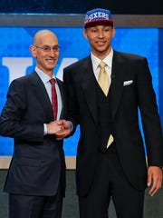 Ben Simmons poses with NBA Commissioner Adam Silver after being selected as the top pick by the 76ers during the NBA draft in June 2016.