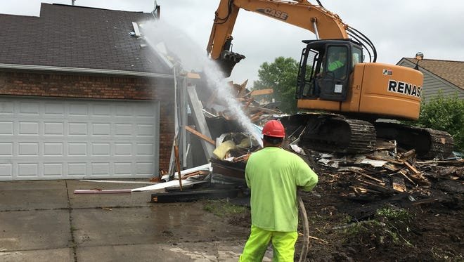 Demolition contractor Renascent tears down an abandoned house at 1726 River Shore Parkway in Indianapolis. It's the first home to be demolished as part of Mayor Joe Hogsett's pledge to tear down or rehabilitate 2,000 houses.