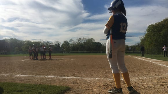 Ardsley's Marie McNerney (13) waits for her at-bat against Eastchester during a league softball game on May 10, 2017