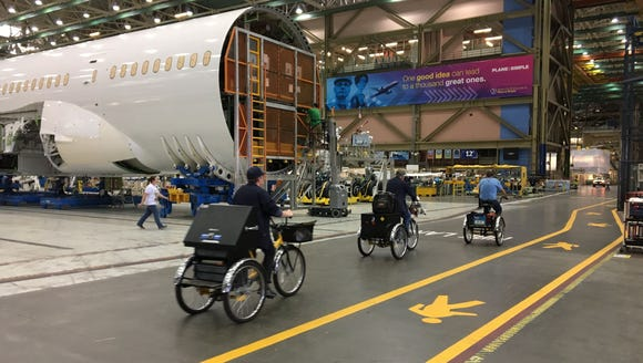 Boeing's Everett assembly line is one of the largest buildings in the world. Bike and pedestrian lanes act as thoroughfares through the giant complex.