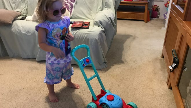 Isabella loves her toy lawn mower. Toys like these are rarely marketed toward girls.