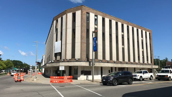 Asbestos abatement is underway on the former Citizens Bank building in East Lansing, which sits on the future site of the $154-million Park District Project.