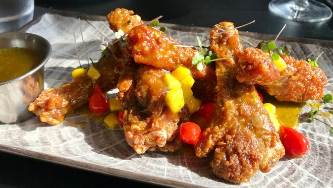 Duck wings in a citrus-chipotle glaze with mango and teardrop peppers from Gather.