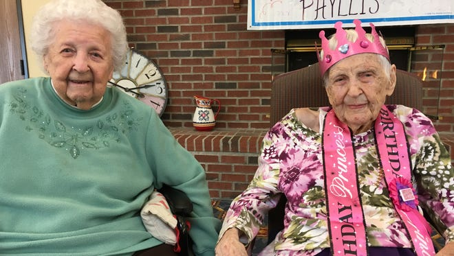 Birthday girl Phyllis Brown (right), who recently turned 105 years-old, with fellow Ashford Commons resident Ruth Barter, who turned 100 last August.