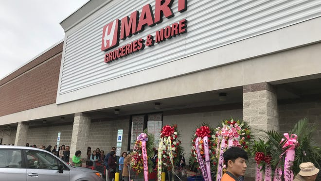 Opening day crowds outside the H Mart Asian supermarket in Paramus.