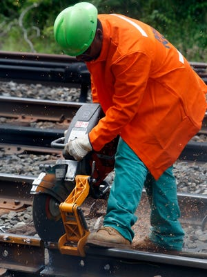 A Metro-North employee prepares a rail for pot welding Wednesday  near the Hastings-on-Hudson station.