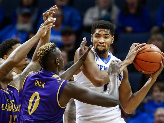 University of Memphis forward Dedric Lawson (right) grabs one of his 14 rebounds against East Carolina University during second half action at the FedExForum.
