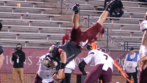 Troy Trojans quarterback Kaleb Barker (7) jumps over the Texas State line for a touchdown during a football game between the Troy Trojans and the Texas State Bobcats on Nov. 24, 2017, at Veterans Memorial Stadium in Troy.