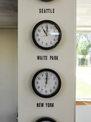 Clocks tell the time on a wall of the new Executive