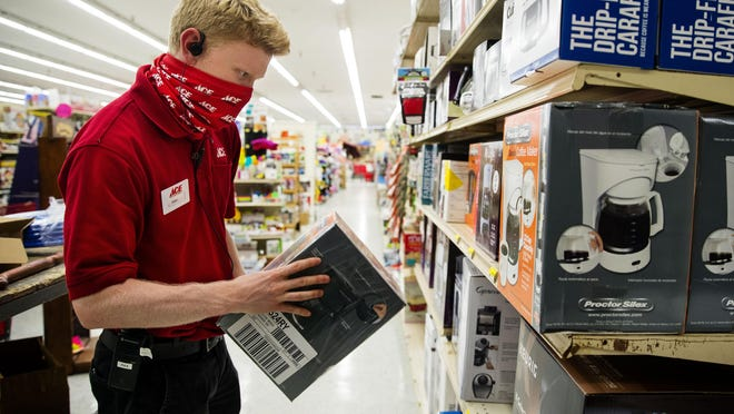 Max Hartwig stocks inventory at Ace Hardware at 1600 Wabash Ave. in Springfield Wednesday, July 8, 2020. The business is one of many in Springfield that used money from the Paycheck Protection Program to keep employees working during the COVID-19 pandemic.