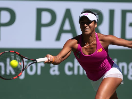 Heather Watson of Great Britain returns the ball to Galina Voskoboeva of Kazakhstan during the BNP Paribas Open on Wednesday, March 9, 2016 in Indian Wells, CA.