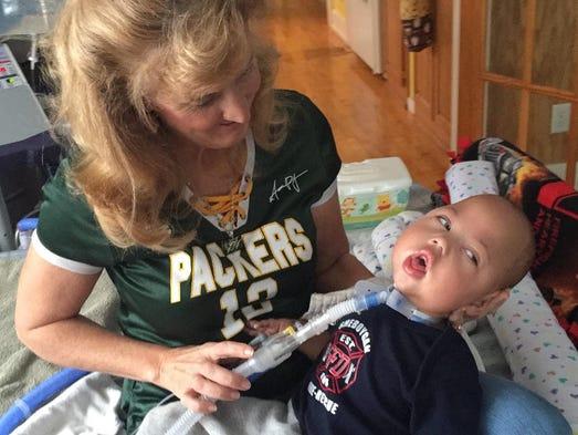 Adoptive mother Cori Salchert poses with Charlie Salchert