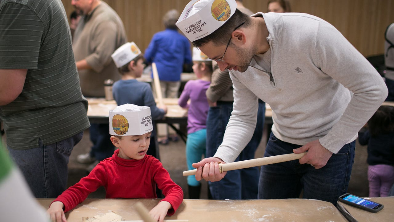 George Milevich brings his son to the Model Matzah Bakery and reflects on his time learning from Rabbi Nechemia Vogel. Video by Mike Bradley. (April 10, 2016)