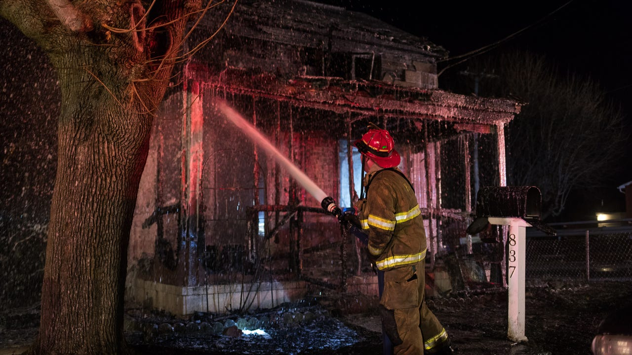 The Evening Sun freelance photographer Harrison Jones was riding along with fire crews on Saturday night when units were dispatched to a house fire in Penn Township.