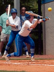 University of West Florida's Rachel Wright, (No. 14) goes for the high bunt during Thursday's first round NCAA South Region game against Claflin University.