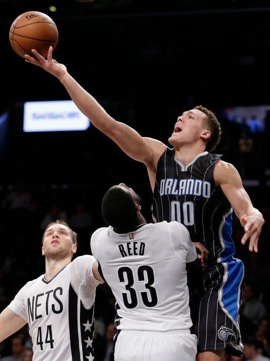 Orlando Magic forward Aaron Gordon (00) shoots against Brooklyn Nets forward Willie Reed (33) during the second quarter of an NBA basketball game, Friday, Jan. 8, 2016, in New York. (AP Photo/Julie Jacobson)