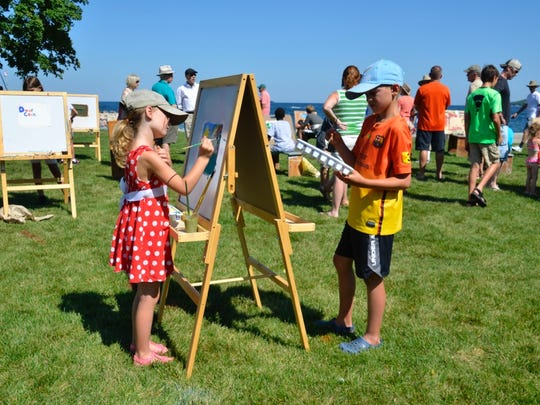 Children are invited to paint during theFeatured Artists' Quick Paint at Waterfront Park in Sister Bay.