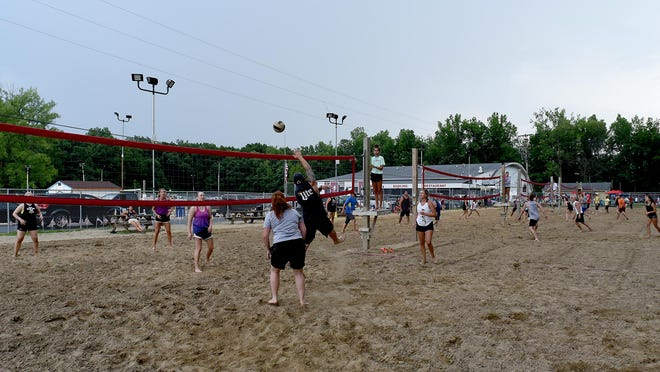Courts 1-5 of sand volleyball matches at Forest View Lanes Recreation Bar and Grill in Temperance.