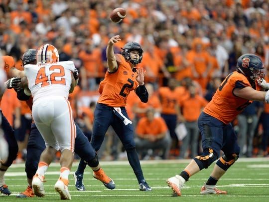FILE - In this Oct. 13, 2017, file photo, Syracuse quarterback Eric Dungey (2) throws a pass during the second half of an NCAA college football game against Clemson in Syracuse, N.Y. Syracuse upset Clemson, 27-24. The top-ranked Tigers (12-1) undoubtedly have the worst defeat among the four teams in the College Football Playoff, really one of the worst for any team in the Top 25. When Syracuse stunned Clemson in mid-October, it was the last win of the season for the Orange. They finished with a five-game skid and a 4-8 record. Clemson, of course, didn't lose again. The Tigers had only one close call the rest of the way, romping to the Atlantic Coast Conference title and setting up a New Year's night rematch against No. 4 Alabama in the Sugar Bowl semifinal game. (AP Photo/Adrian Kraus, File)
