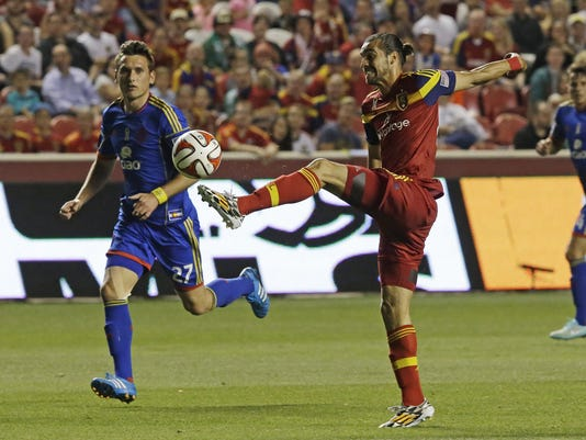 Real Salt Lake Sebastian Jamie, right, controls the ball as Colorado Rapids defender Shane O'Neill (27) looks on in the first half during an MLS soccer game Friday, Sept. 19, 2014, in Sandy, Utah. (AP Photo/Rick Bowmer)