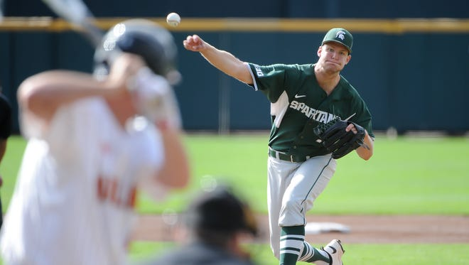 Michigan State pitcher Ethan Landon throws during the second inning against Maryland at TD Ameritrade Park.