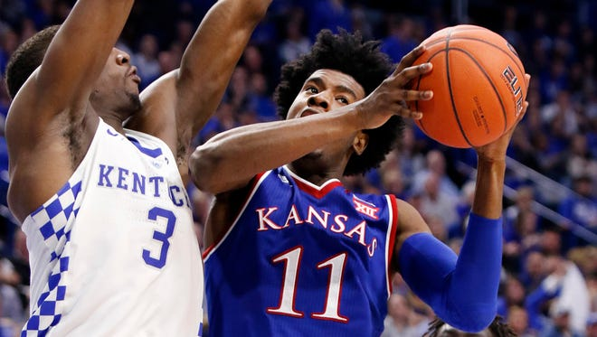"Kansas' Josh Jackson (11) shoots while defended by Kentucky's Edrice ""Bam"" Adebayo (3) during the second half."